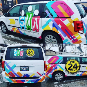 a van with bright colourful logos on it