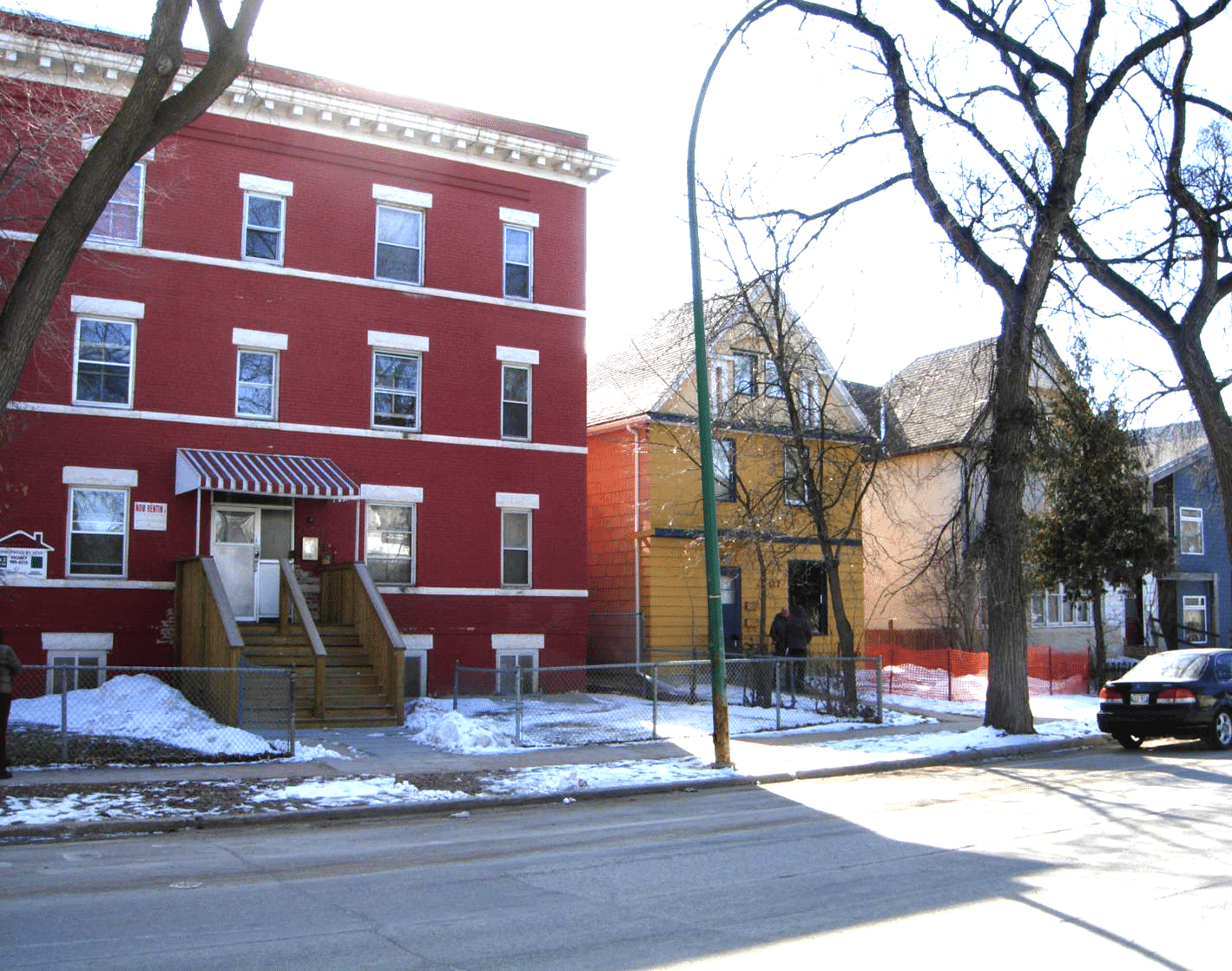 Picture of apartment building and houses