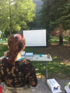 Young person playing Wii in the park