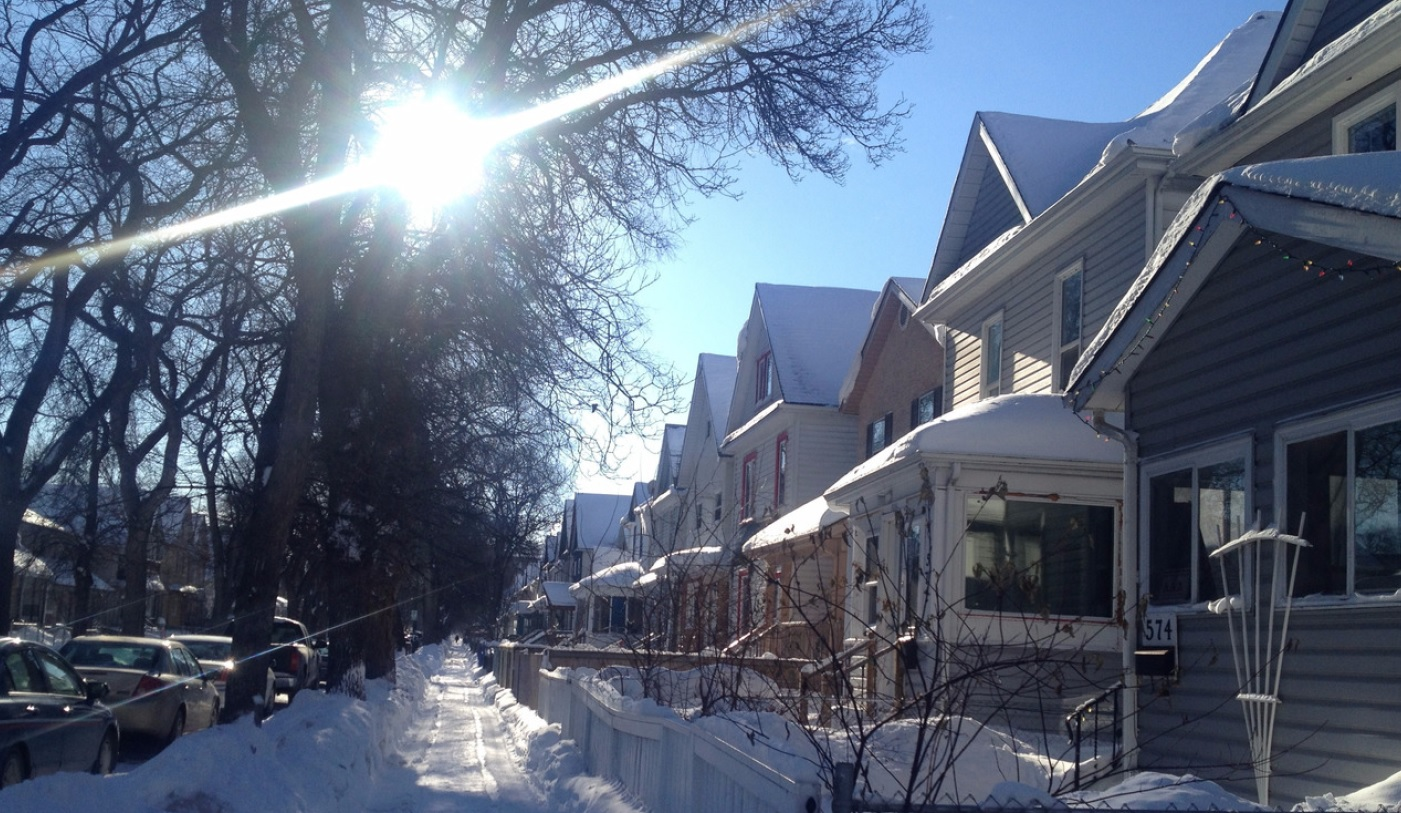 houses down a street in winter