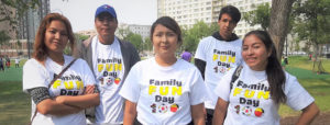 a group of young adults help out at Family Fun Day