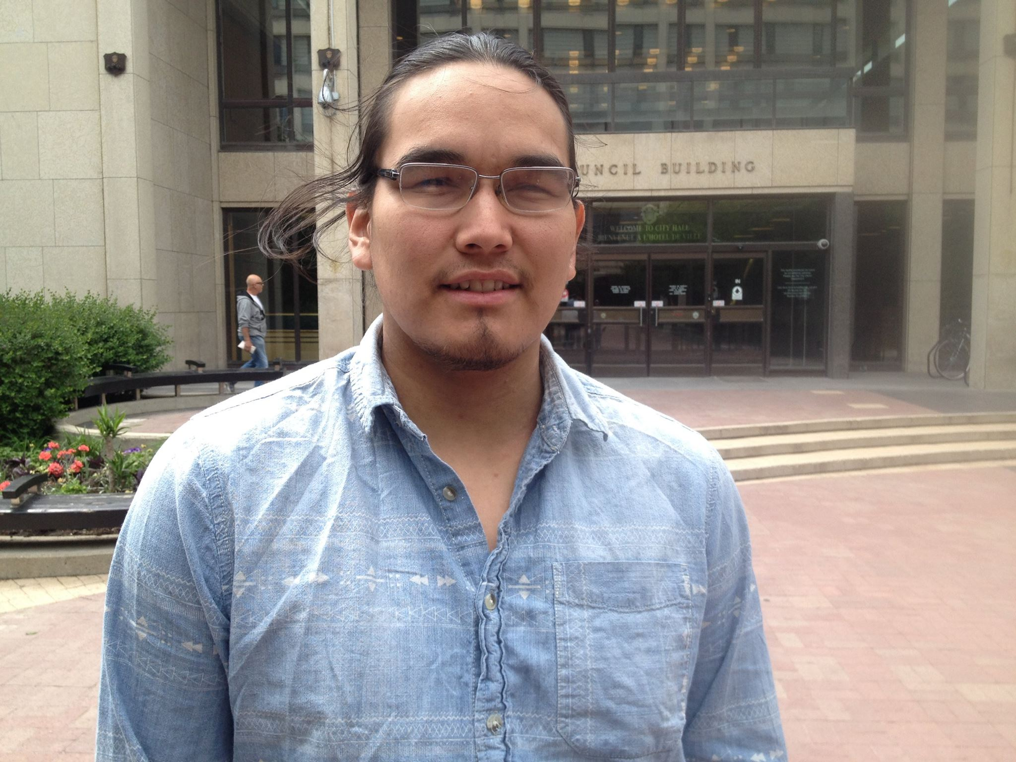 Kevin Settee stands outside the Winnipeg City Council building