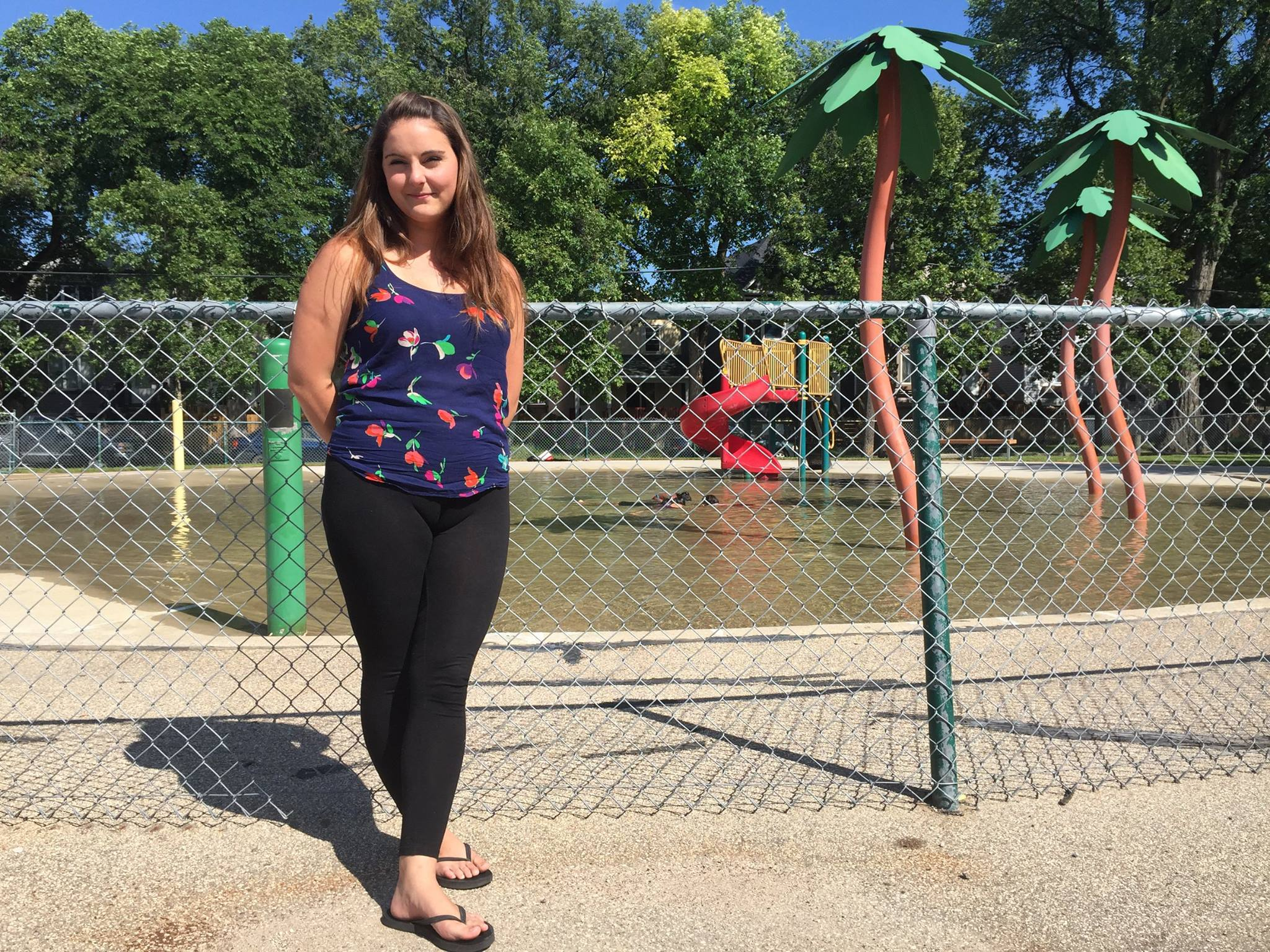 Lin stands in front of an outdoor splash pad